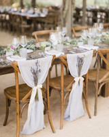 lavender bouquets tied to sheer fabric on reception chairs