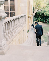 emme daji wedding back of couple walking down stairs