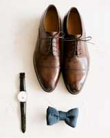 Brown Bonton dress shoes, navy bowtie and leather watch groom accessories