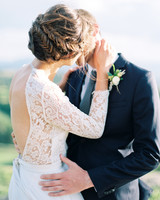 bride with dramatic back and fishtail updo