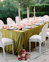 tall candles and floral arrangements on reception table