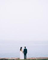 wedding couple by sea horizon
