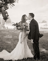 jen geoff wedding kiss in field