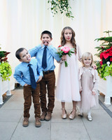 four kids at a wedding