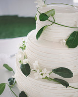 Three-Tiered White Wedding Cake with Wraparound Stephanotis Vines