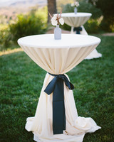ribbon wedding ideas black ribbon cinching linen on cocktail table