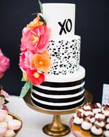 Modern Black and White Cake with Bright Flowers and Gold Cake Stand