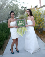 "brides holding ""I love my wife"" sign"