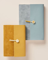 tan and blue vow books with fold over tie