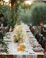 anika max wedding reception table with linens centerpieces and table settings