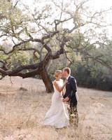 ashlie adam alpert wedding couple kissing in front of tree