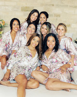 bridal party wearing matching floral print robes