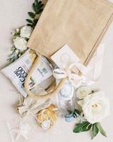 burlap welcome bag with water and snacks