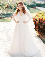 bride with v-neck gown and hair half up half down