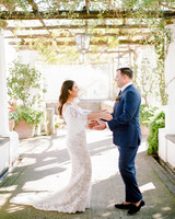 bride and groom first look in Italian garden terrace area