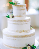 Three-Tiered Naked White Wedding Cake with Sparse Flowers