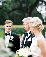 bride with her father during processional before meeting the groom