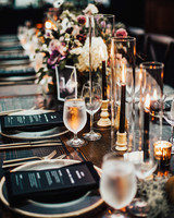 long wood tables with black and clear glass tableware