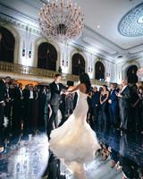 wedding couple dancing on mirrored ballroom floor