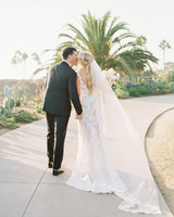 mykaela and brendon wedding bride and groom holding hands kissing