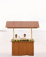 sara danny mexico wedding couple coconut stand on beach