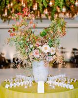 stone vase centerpiece on yellow tablecloth