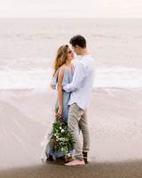 couple embrace on beach engagement photo