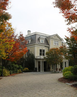 oceanside resort surrounded by fall foliage