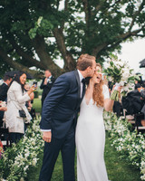 bride groom wedding recessional kiss