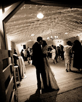 barn wedding kiss