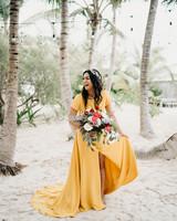 beach wedding dresses bride in yellow dress under palm trees