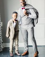 groom in grey suit with ring bearer in brown suit