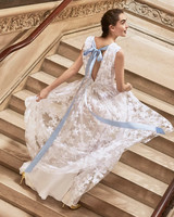 Carolina Herrera wedding dress spring 2019 floral lace with blue ribbon in back