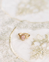 engagement rings pink lavender oval stone framed with round cut diamonds