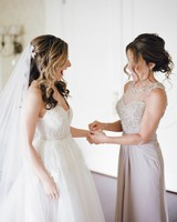 A Mother Helping Her Daughter with Her Wedding Jewelry