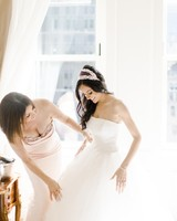 A Mother Helping Her Daughter with Her Wedding Dress