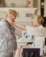 A Bride and Her Mother Getting Ready for Her Wedding