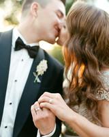 rae rob wedding couple kiss and rings