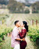 couple kissing in vineyard engagement photo
