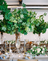 tall centerpiece with greenery