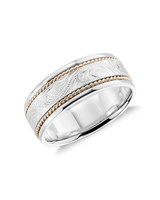 silver and gold ornate wedding band