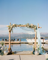 lake front wedding floral archway with boat in background