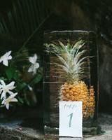 wedding ice sculpture frozen pineapple table numbers
