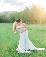 allison aimee wedding kiss in field