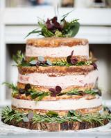 naked cake with fresh flowers plants garnish
