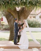 ashlie adam alpert wedding ceremony couple and officiant