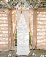 wedding ceremony backdrop hanging scroll candles rocks