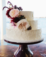 Textured Wedding Cake with Red and Pink Flowers