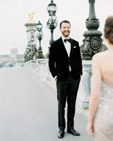 bride and groom sharing first look on bridge
