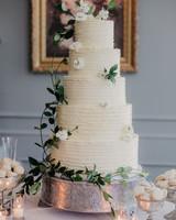 large white wedding cake with silver base